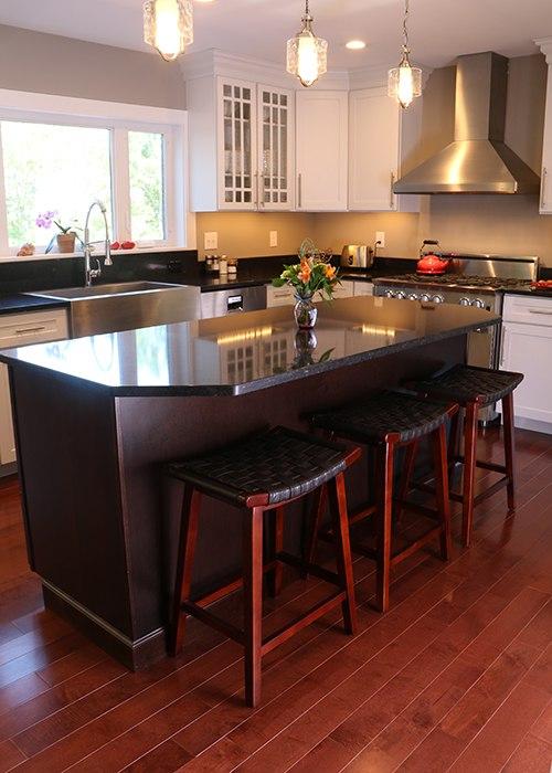 White Kitchen Featuring Dark Cherry Island