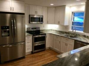 customer submitted image of white kitchen with hardwood floors