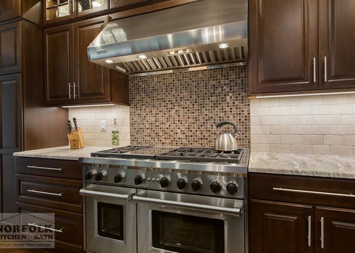 Stainless stove/oven hood with mosaic tile backsplash