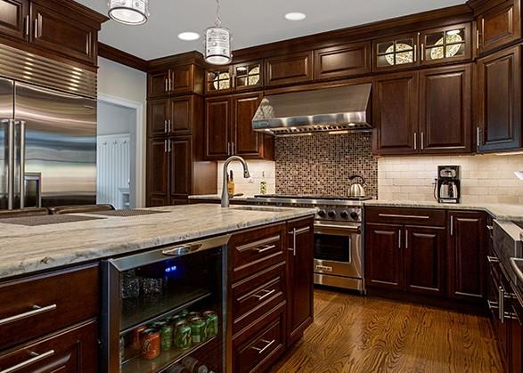 Cherry Kitchen with medium toned hardwood flooring