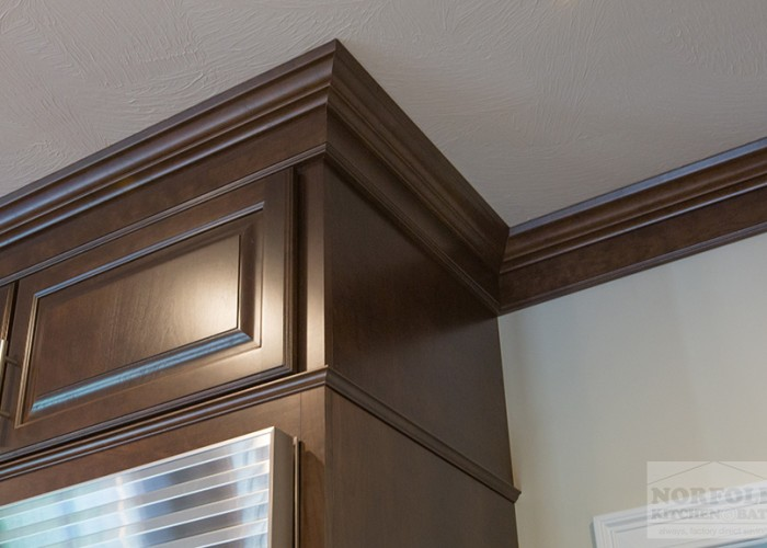 Cherry crown moulding to ceiling