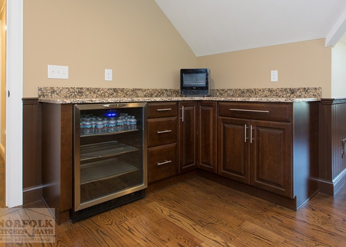 Cherry cabinetry with mini fridge