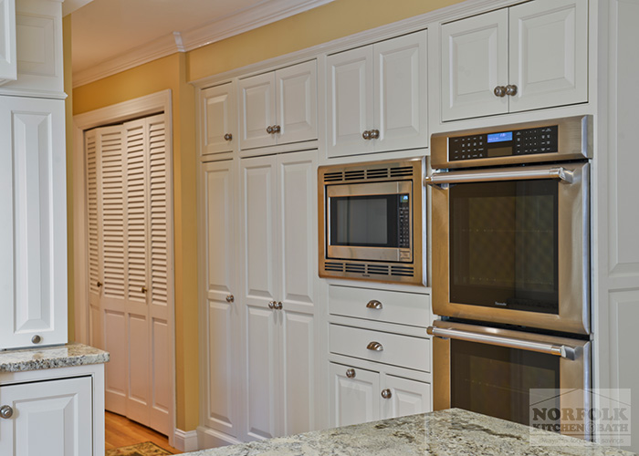 White inset cabinets with Stainless appliances