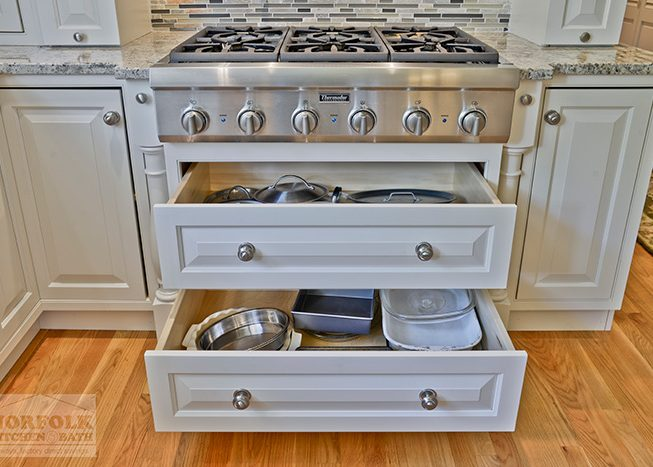 Stove with storage compartments