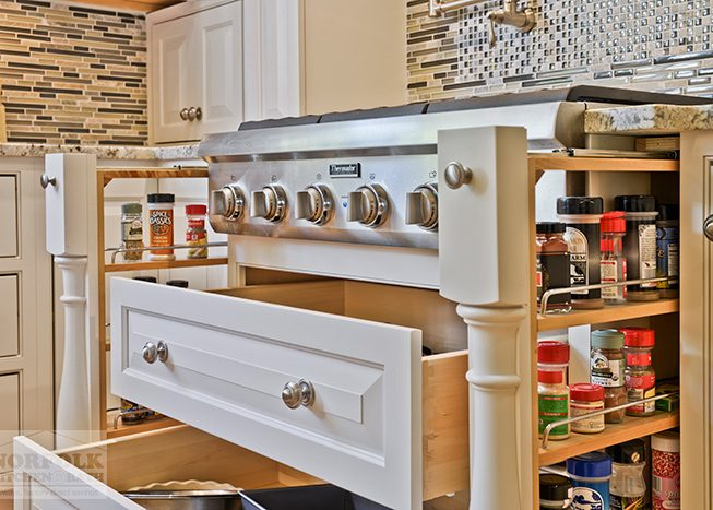 Stove with pullout spice racks and storage compartments