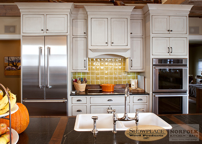 Showplace Painted White inset cabinets with stainless appliaces