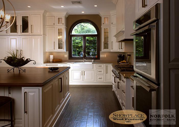 Showplace Painted White Kitchen with dark hardwood flooring