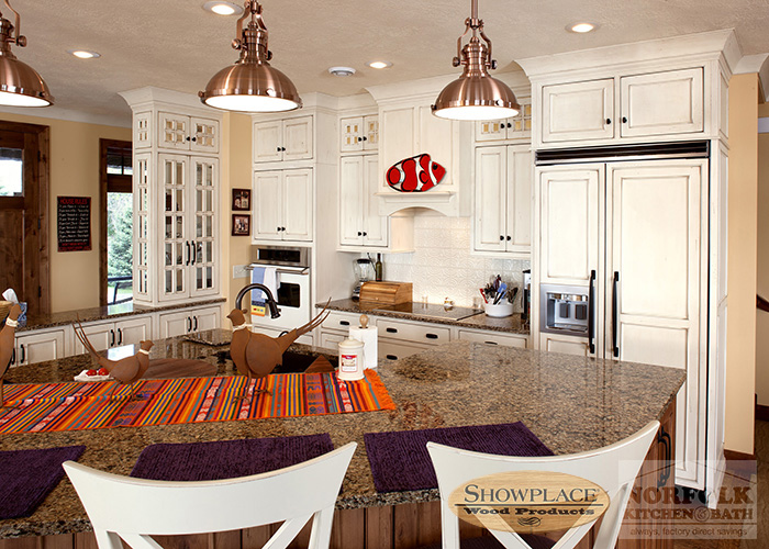 Showplace Painted White cabinetry with glass doors