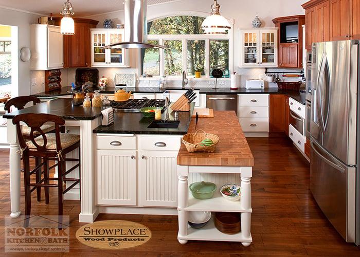 Showplace White Kitchen with dark hardwood flooring