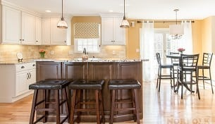 White Kitchen With Maple Accent Island