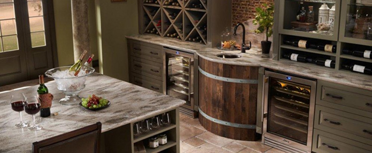 a bar area with brown cabinets and wine storage with solid surface countertops