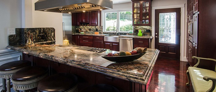 a cherry kitchen remodel with granite countertops with a double ogee edge