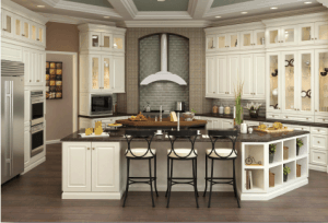Large white kitchen with oversized island and brown stools