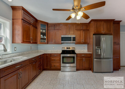 backed away image of medium stained maple cabinets