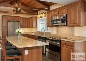 wood kitchen with granite tops and island