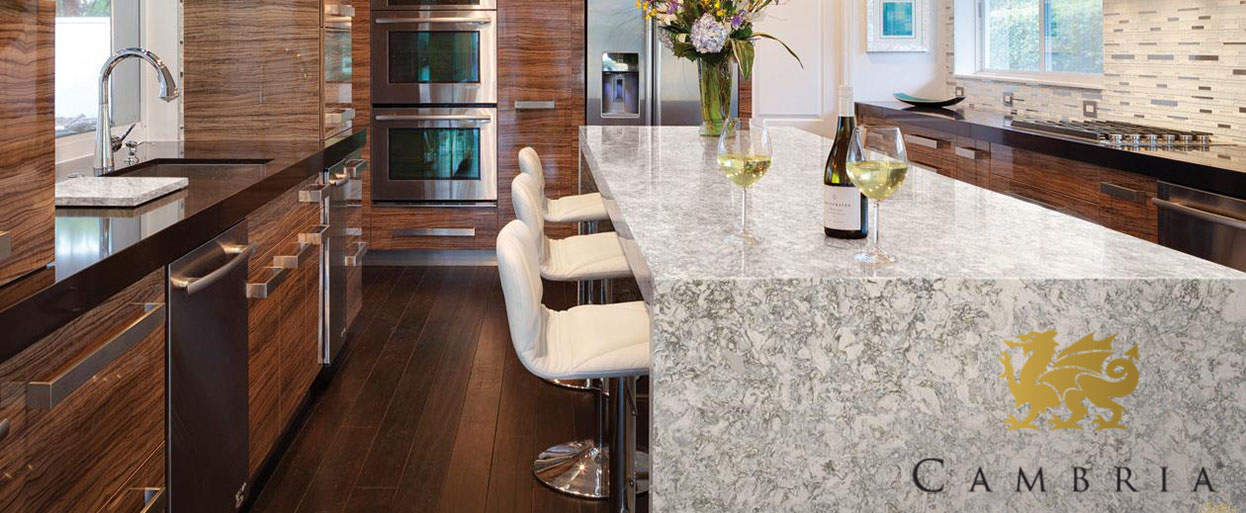 a kitchen with a cambria quartz countertop with a waterfall edge