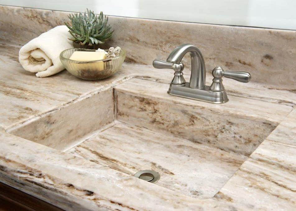 a solid surface vanity countertop with an integrated sink