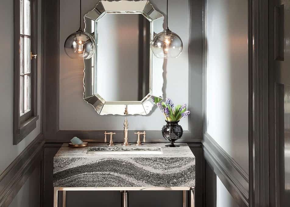 a bold cambria quartz vanity countertop with a thick edge profile in a modern bathroom