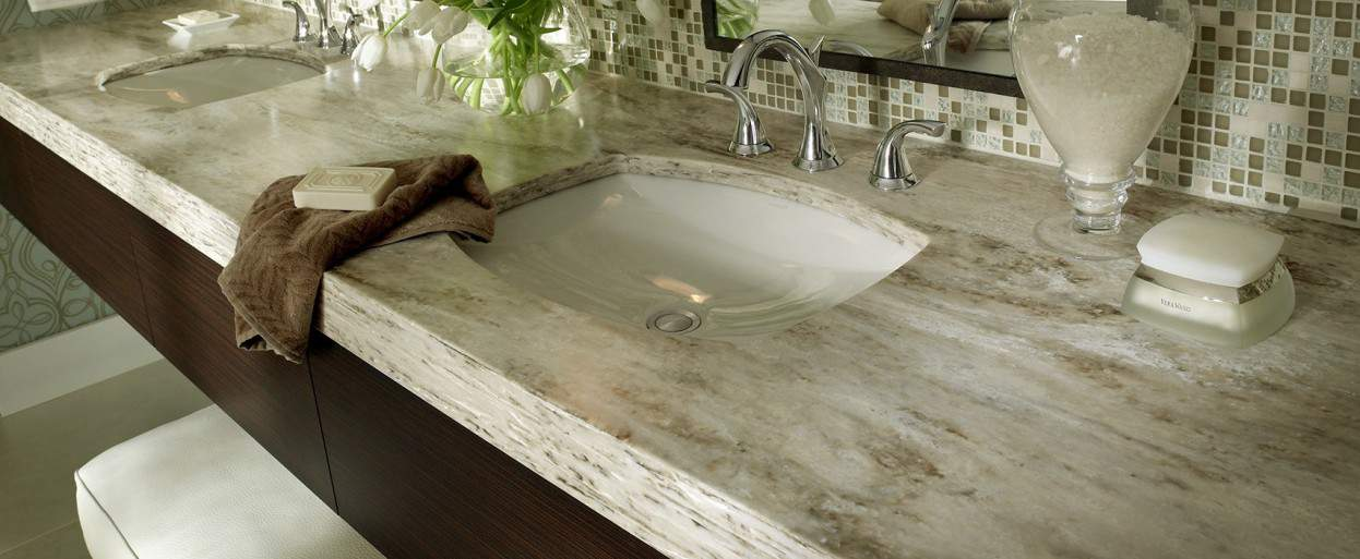 close up of a solid surface bath vanity countertop with double sinks