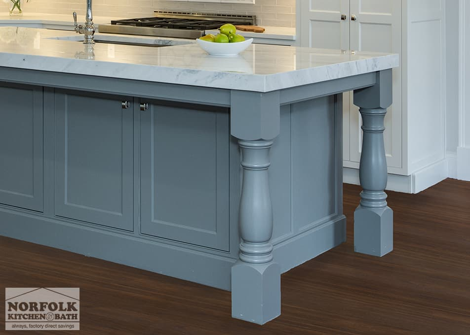 gray kitchen island with stone countertops and furniture posts