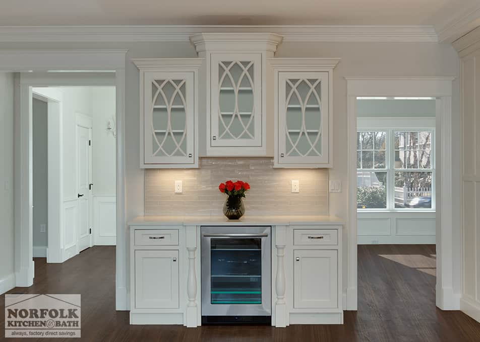 white kitchen cabinets with gothic window feature and wine fridge