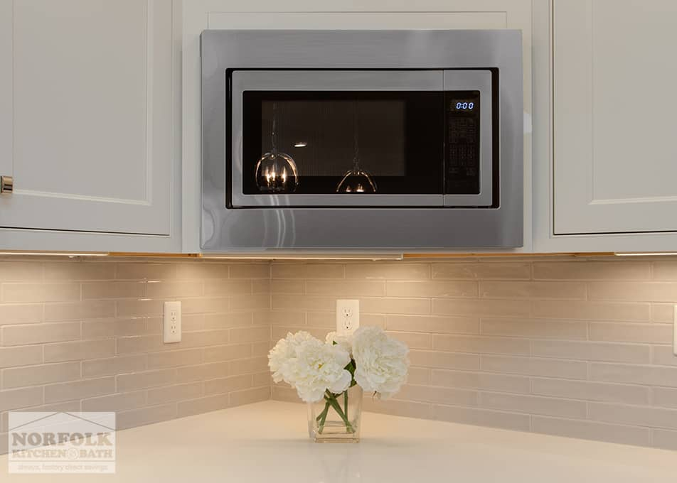 white kitchen cabinets with microwave insert