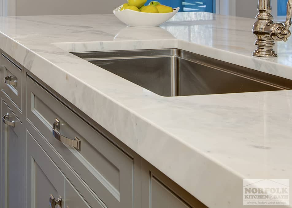 stone kitchen countertop on gray cabinets with undermount stainless steel kitchen sink