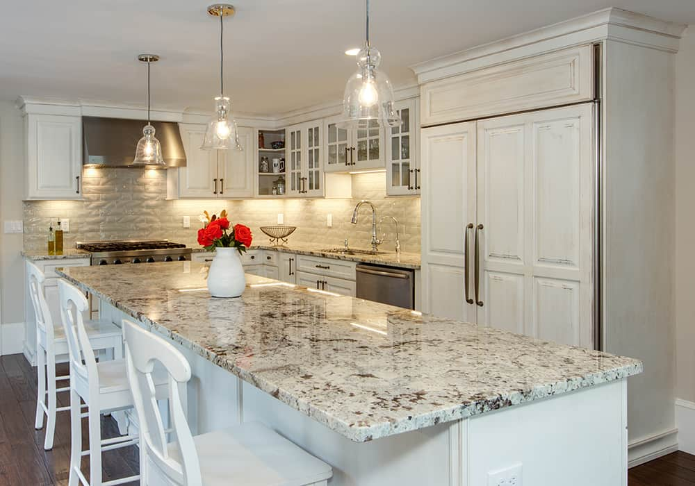 White kitchen with island and stainless appliances