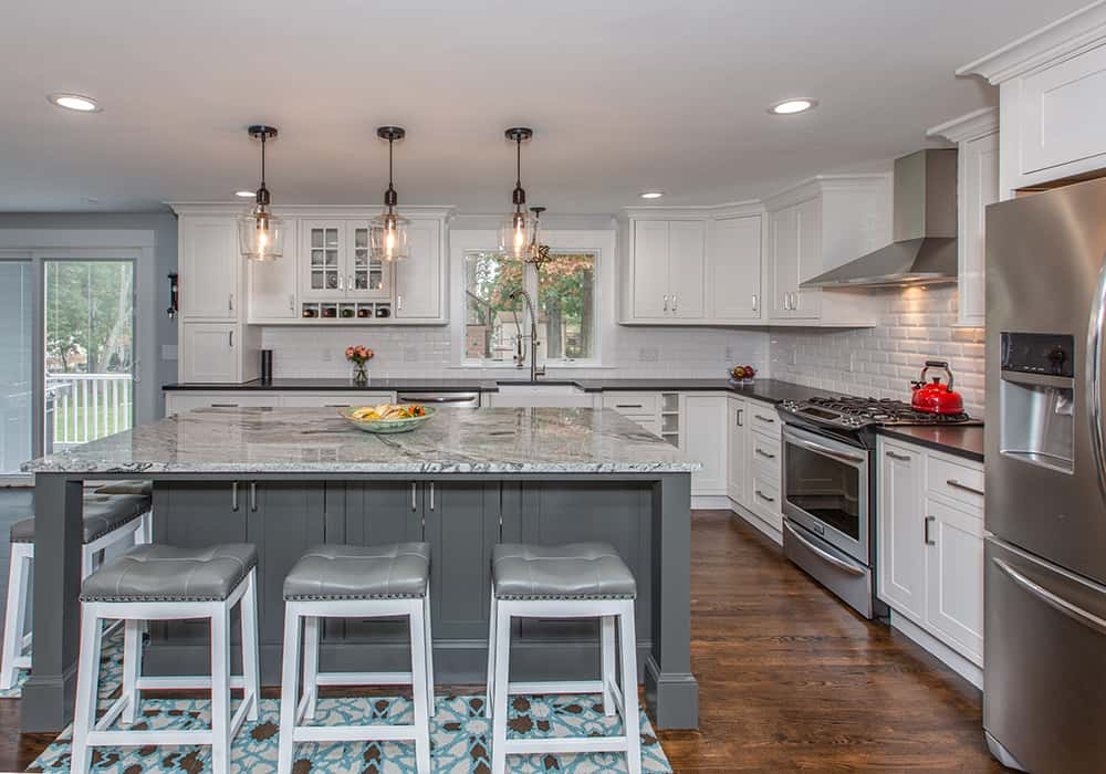 white kitchen with grey island in customer project