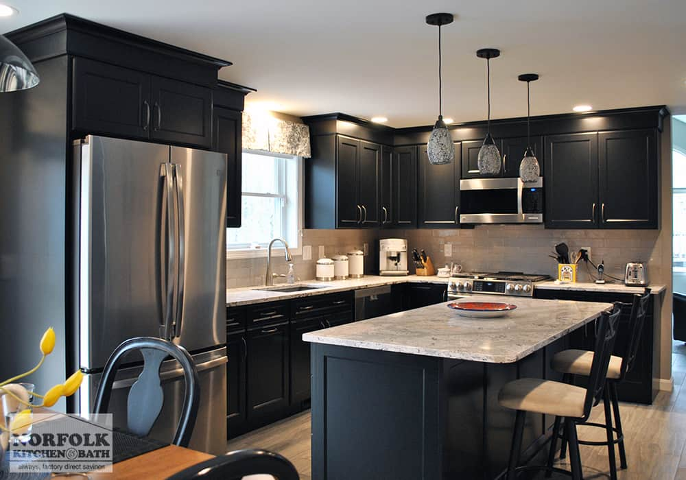 dark color wood kitchen with island and stone countertops