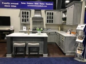Norfolk Kitchen & Bath's trade show booth with a kitchen display at the New England Home Show in Boston, MA