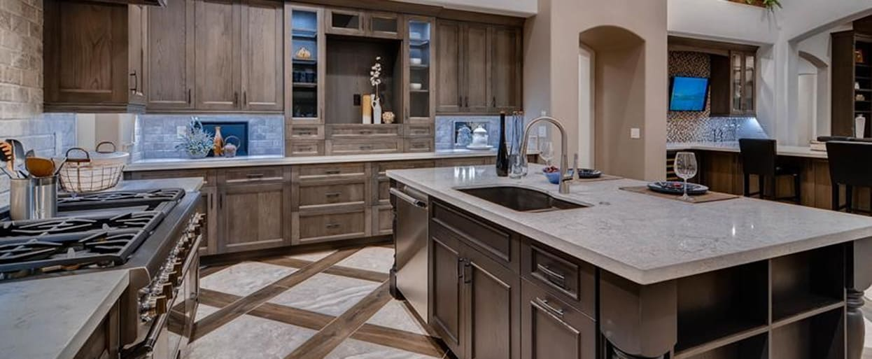 showplace cabinetry all-wood kitchen with stained cabinets and stone countertops
