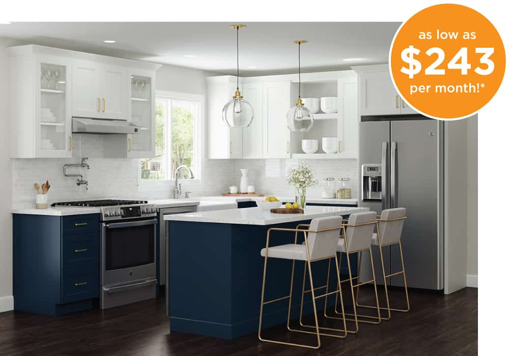 A custom white and blue kitchen with an island and quartz countertops - only $15,999 or as low as $243 per month
