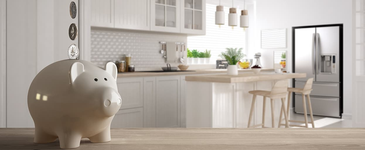 Wooden table top or shelf with white piggy bank with coins, scandinavian white and wooden kitchen, expensive home interior design, renovation restructuring concept architecture