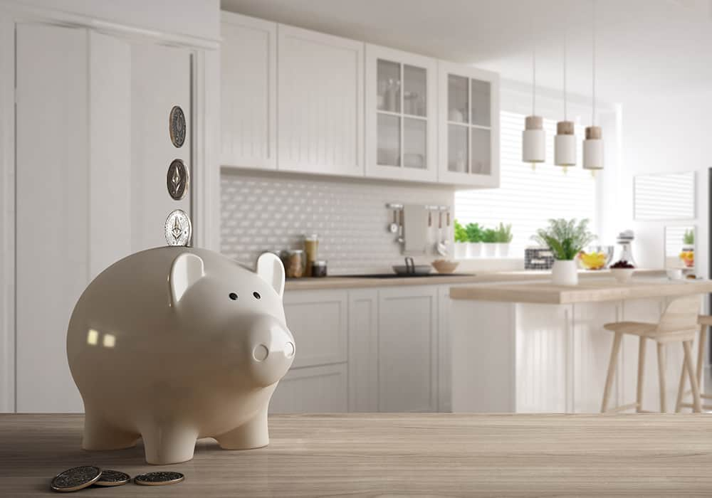 a white ceramic piggybank with a white kitchen in the background