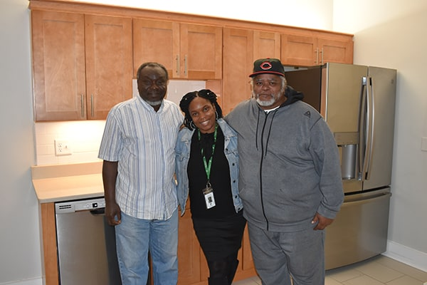 Yearwood House tenants with their property manager