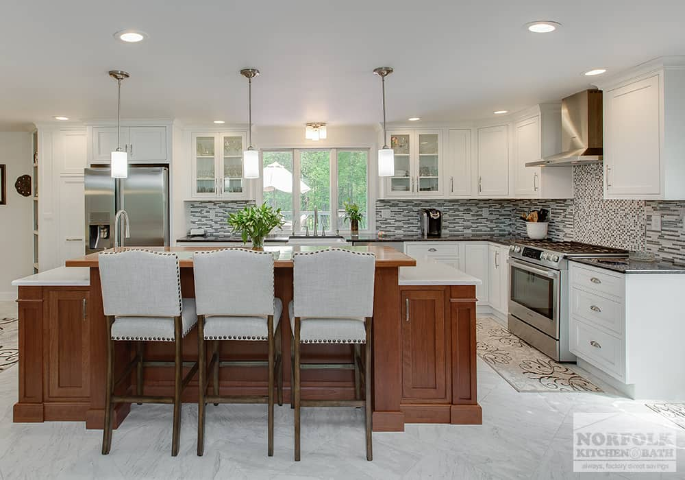 classy white kitchen with glass doors and all wood island and 3 decorative stools