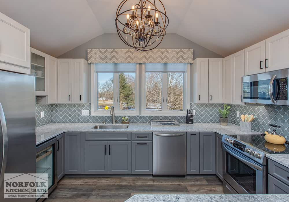 grey kitchen with white wall cabinets