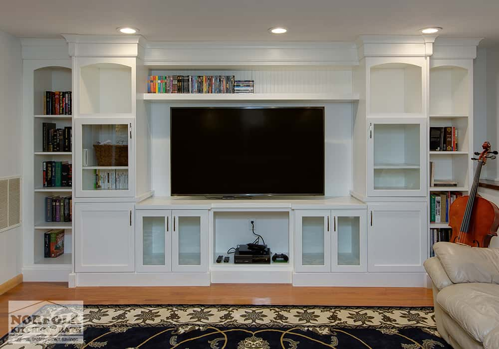 white cabinet entertainment center with built in bookshelves