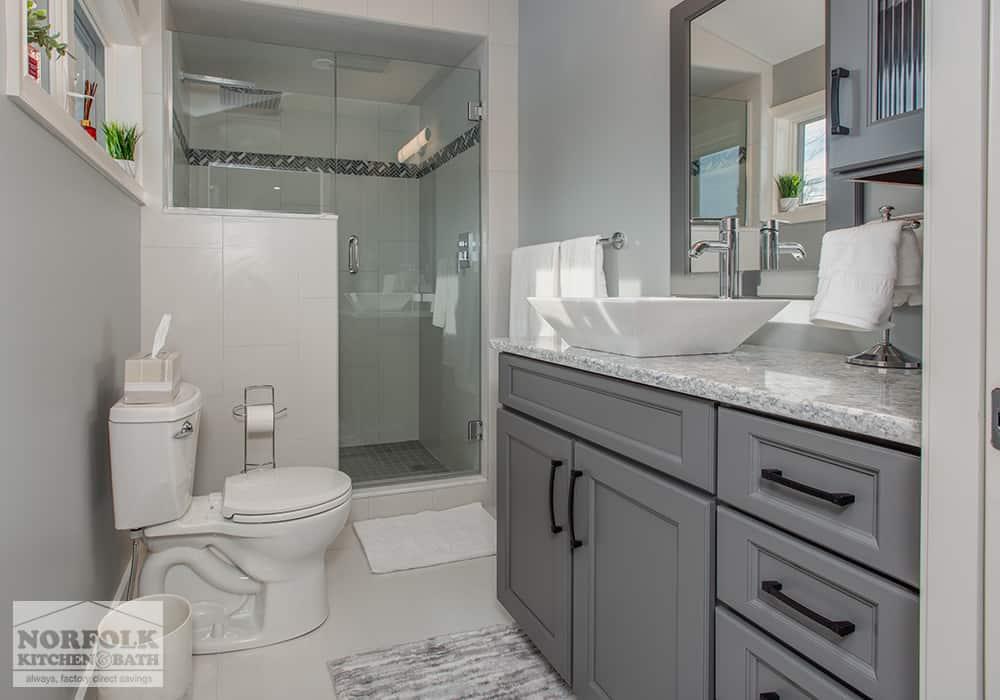 dark grey bath vanity with black pulls in bathroom