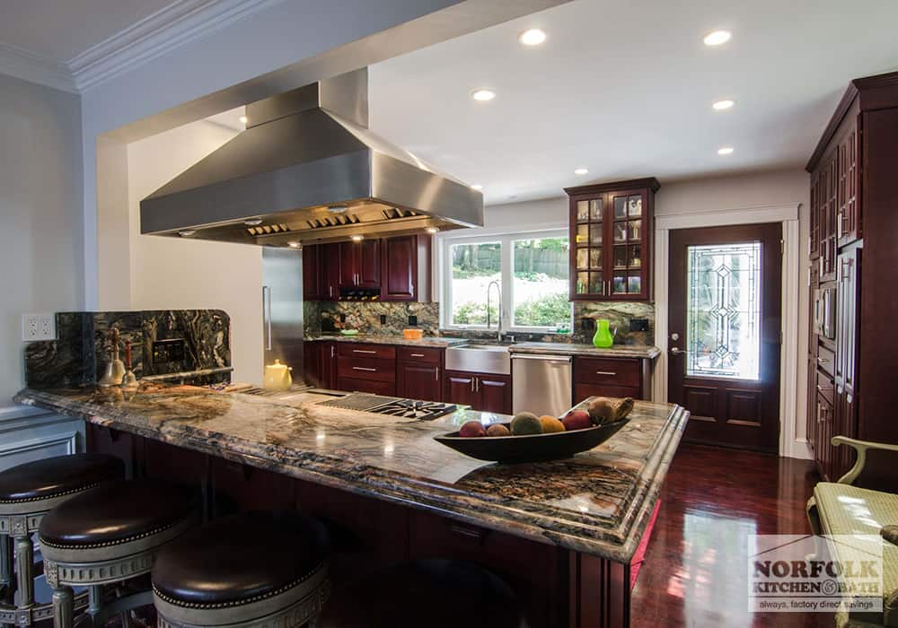 kitchen island with cherry cabinets and stacked edge granite