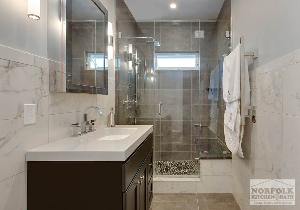 glass door shower and vanity fully tiled bath