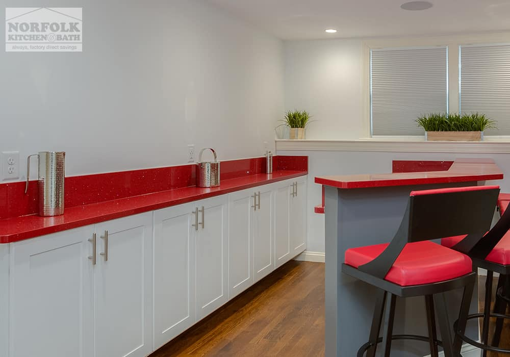 white cabinets in home at bar with bright red quartz tops