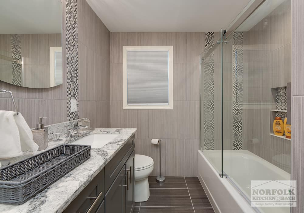 bathroom with quartz top and tiled walls and floor