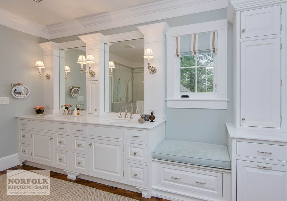 double sink white vanity with built in seat and decorative moldings