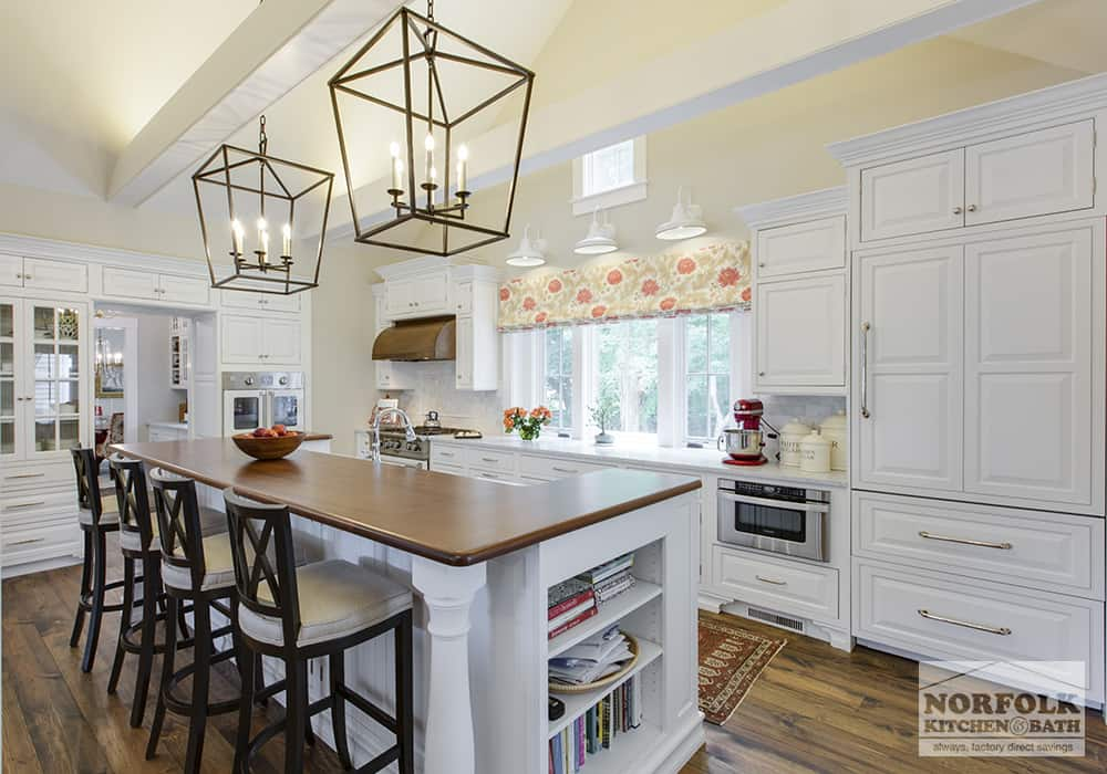 beautiful white kitchen with island wood countertops and hardwood floors