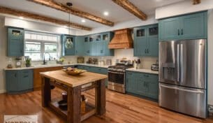Teal Farmhouse Kitchen With Wood Accents