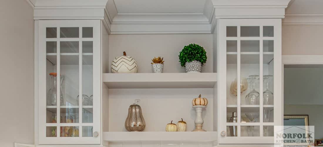 decorative white glass mullion cabinet doors with 2 floating white shelves underneath