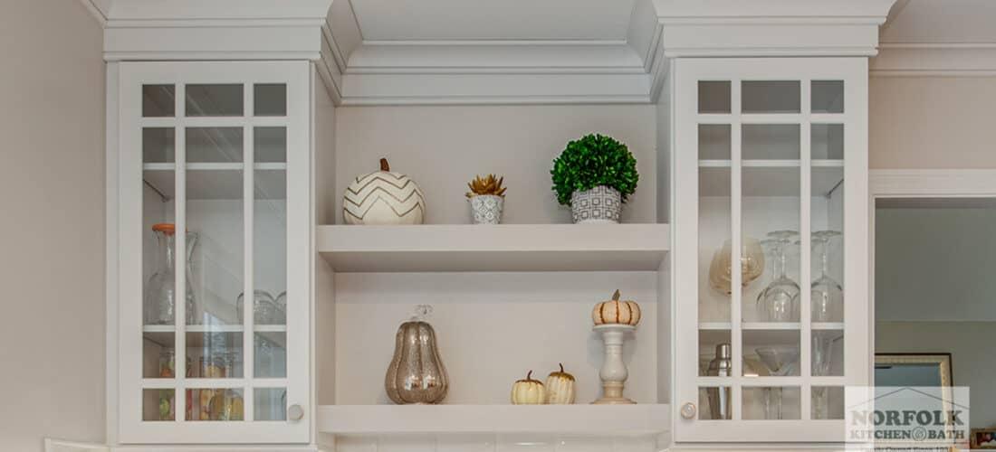 decorative white glass mullion cabinet doors with 2 floating white shelves underneath