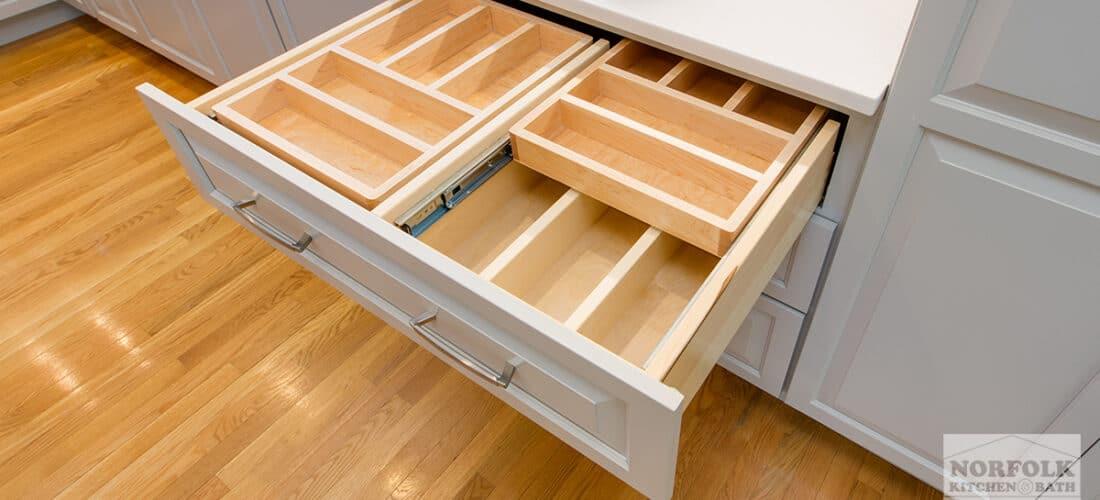 an empty kitchen drawer in a gray kitchen with 2 tier wooden drawer organizer upgrade